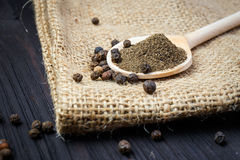 Black pepper on the wooden spoon Stock Photography