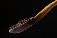 Black pepper in wooden spoon Royalty Free Stock Photography