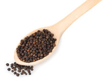 Black pepper in wooden spoon isolated on white background Royalty Free Stock Image