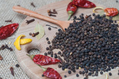 Black pepper on wooden spoon Stock Photos