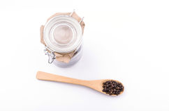 Black pepper in wooden spoon Royalty Free Stock Photo