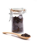 Black pepper in wooden spoon Stock Photography