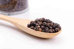 Black pepper in wooden spoon Royalty Free Stock Photos