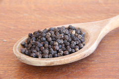 Black pepper on a wooden table. Stock Photography