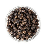 Black Peppercorns. In glass bowl, isolated and shot from directly above royalty free stock image