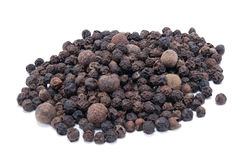 Black peppercorns. Pile of black peppercorns isolated on white Royalty Free Stock Image
