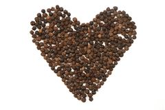 Black peppercorns. Stock Images