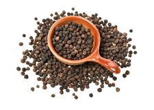 Black peppercorns. On white background stock photo