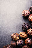 Black Peppercorns closeup. Black pepper on dark background with Stock Photography