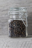 Black peppercorns in jar Royalty Free Stock Images