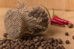 Black peppercorns in a jar Royalty Free Stock Photography