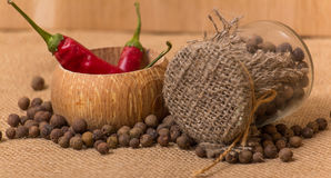 Black peppercorns in a jar Stock Images