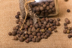 Black peppercorns in a jar Stock Photos