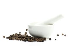 Black peppercorns with mortar Royalty Free Stock Photos