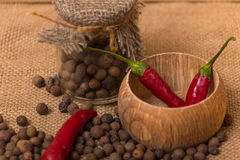 Black peppercorns and red pepper Stock Photo