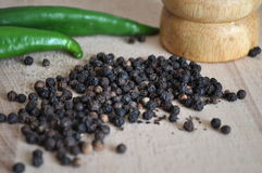 Black peppercorns. On a wooden background Stock Photography