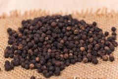 Black peppercorns Stock Photos