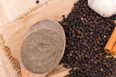 Black peppercorns Stock Images
