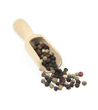 Black peppercorns on a wooden spoon Stock Photos