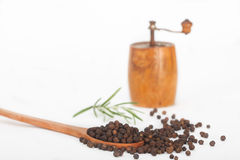Black peppercorns in wooden spoon Stock Photo
