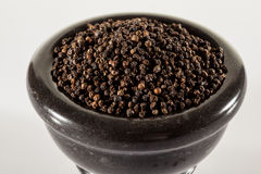 Black peppers in a clay pot Royalty Free Stock Images