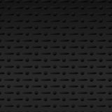 Black perforated metal background Royalty Free Stock Images