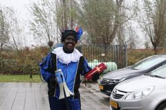 Black Pete, the helper of dutch traditional celebration of Sinterklaas. With megaphone and book.This became big discussion about the black face which could be royalty free stock photos