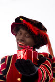 Black Pete showing gift Royalty Free Stock Images