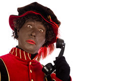 Black pete with telephone Royalty Free Stock Photos