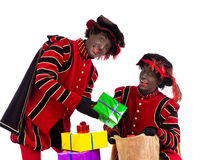 Black Pete  zwarte piet showing gift Stock Photos