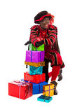 Black Pete  zwarte piet showing gift Stock Photography