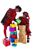 Black Pete  zwarte piet showing gift Stock Photo