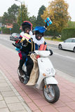 Black Petes on scooter. Dutch characters as black petes for typical Sinterklaas holidays riding on scooter with presents Royalty Free Stock Photography
