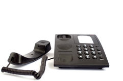 Black phone. On a white background Royalty Free Stock Photography