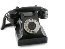 Black phone. Old black phone over white background royalty free stock photo