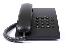 Black phone. On a white background Stock Photos