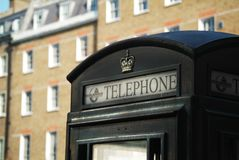 Black phone booth Royalty Free Stock Image