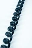 Black phone cord. Close up Stock Photos