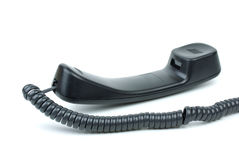 Black phone handset Stock Images