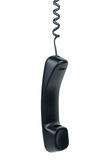 Black phone handset hanging on cord. Isolated on the white background stock images