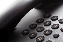 Black phone keypad. With yellow numbers closeup royalty free stock photos