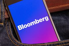 Black phone with logo of news media Bloomberg on the screen stock images