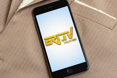 Black phone with logo of news media Eritrean Television Eri-TV on the screen. stock photography