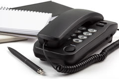 Black phone and notebooks on white background Royalty Free Stock Photography