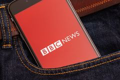Black phone with red logo of news media BBC News on the screen royalty free stock photo