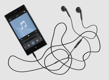 Phone and music. Black phone with ultramodern earphones on a white background Stock Image