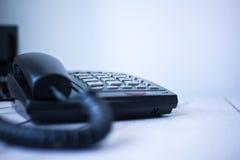 Black phone on wooden desk Royalty Free Stock Photo