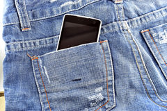 Black phone in your pocket blue jeans Royalty Free Stock Photo