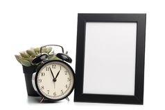 Black photo frame and clock isolated on white background, succulent behind royalty free stock photos