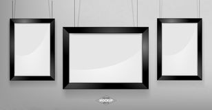 Black photo frame Mockup. Vector Illustration. Black photo frame Mockup Vector Illustration. Empty red photo frames mockup on a concrete wall Stock Photo